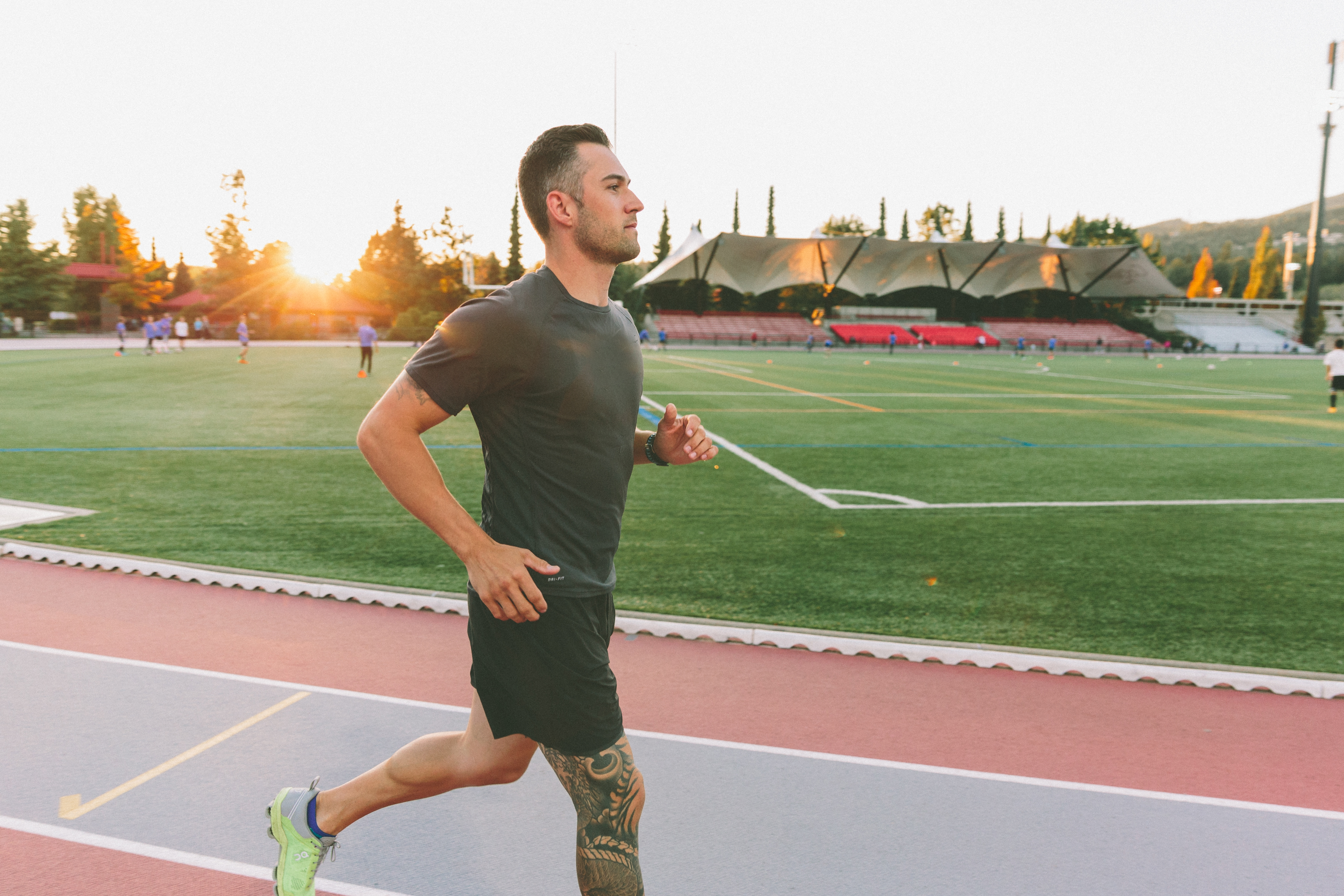 sunset-running-determination-track-man-training-fitness-work-out-active-golden-hour_t20_BlpYw9